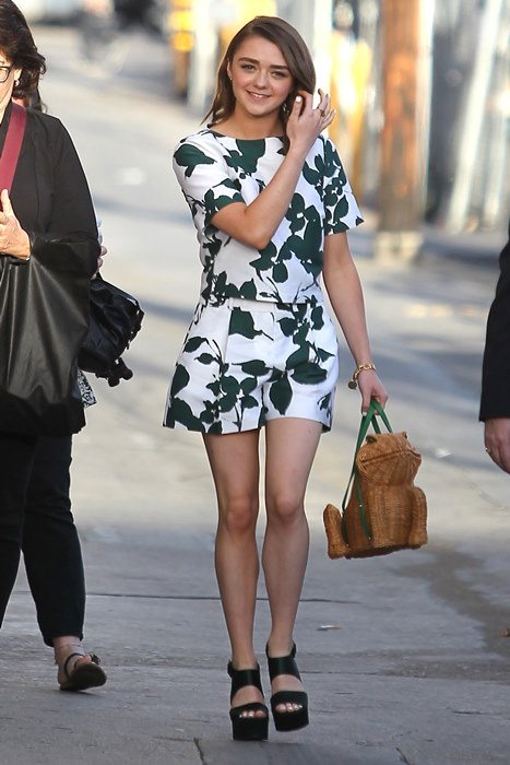 Hollywood, CA - Actress, Maisie Williams, brought her fun side to Jimmy Kimmel Live when she brought a frog basket handbag to the show. The 'Game of Thrones' actress paired the whimsical handbag with a green leaves jumper and black platform heels. AKM-GSI March 24, 2015 To License These Photos, Please Contact : Steve Ginsburg (310) 505-8447 (323) 423-9397 steve@akmgsi.com sales@akmgsi.com or Maria Buda (917) 242-1505 mbuda@akmgsi.com ginsburgspalyinc@gmail.com *** Local Caption *** Maisie Williams